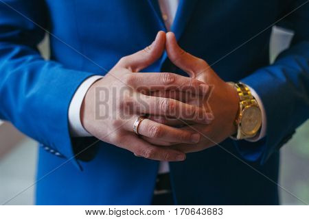 Successful entrepreneur and businessman. Hands of the men conducting the negotiations. Confident married man with clock on hand. Leader Manager