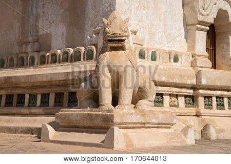 The old sculpture of a mythical monster in the design of a Buddhist temple of Ananda Phaya. Bagan, Myanmar