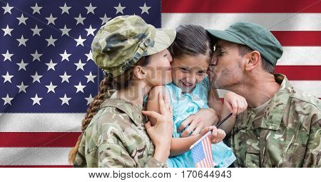 Soldier couple reunited with their daughter against american flag