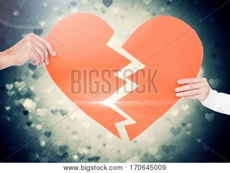 Close-up of hands of couple holding broken heart