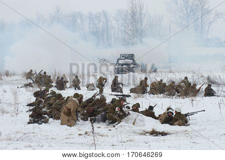KRASNOE SELO, RUSSIA - JANUARY 15, 2017: Soviet infantry prepares to attack. The reconstruction of the battle of the great Patriotic war for the lifting of the blockade of Leningrad