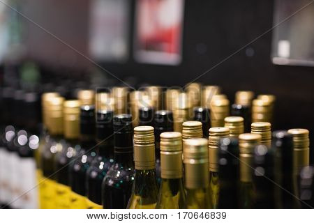 View of shelves with wine in the supermarket