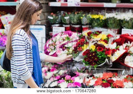 Woman looking at flowers in a shop