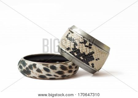 Fake snake and leopard skin bracelets isolated on white background