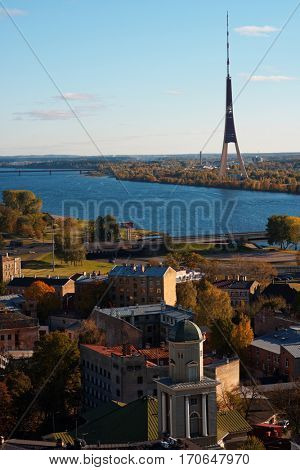 RIGA, LATVIA - OCTOBER 16, 2016: View to the river Daugava and Riga TV tower. Built in 1979-1986, the tower is 386.5 m tall and is the tallest built structure in Baltic countries