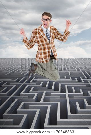 Composite image of businessman jumping over maze