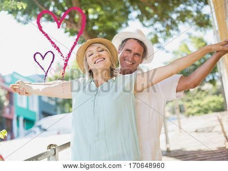 Composite image of senior couple standing with arms outstretched