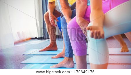 Seniors doing exercises in retirement house