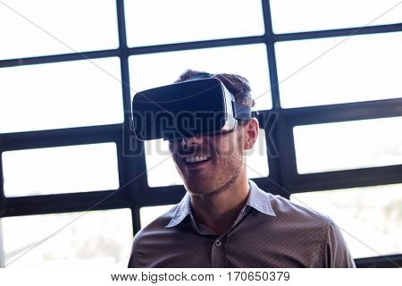 Businessman using virtual reality device in the office