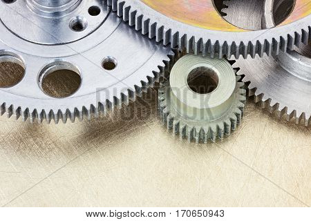 Industrial Cog Wheels And Metal Gears Background Closeup.