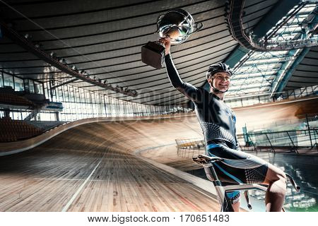 Smiling athlete on a cycle track
