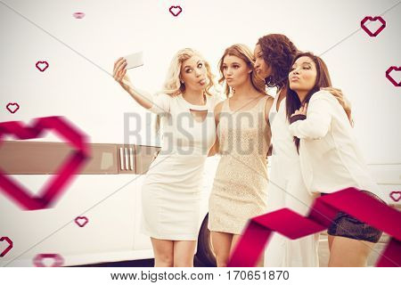 Well dressed women taking selfie against hearts