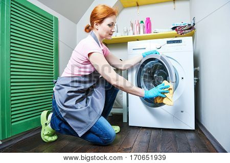 Cleaning service. woman cleanse washing machine