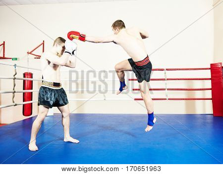 Muay thai fighters at boxing ring