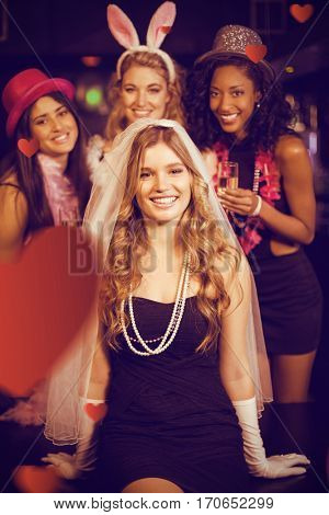 Friends celebrating bachelorette party against hearts