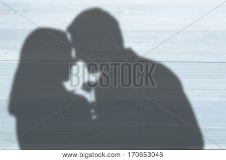 Happy couple holding flower against bleached wooden planks background