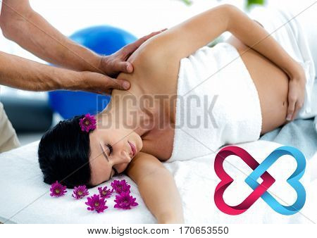 Beautiful woman receiving spa massage with digitally generated heart