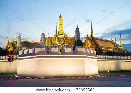 Corner Bastion and the spires of the Royal Palace in the evening twilight. Bangkok, Thailand