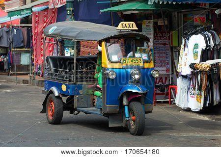 BANGKOK, THAILAND - JANUARY 06, 2017: Thai tuk-tuk is on the street