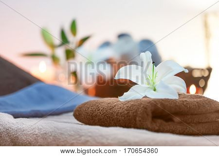 Lilia on towel in spa center on blurred background, close up