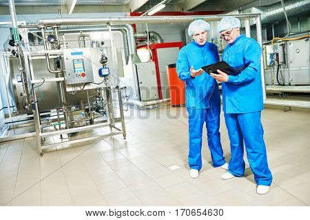 pharmaceutical male workers in water preparation production line