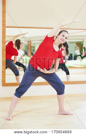 pregnant woman doing fitness exercise