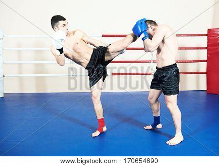 thai sportsman fighting at boxing ring
