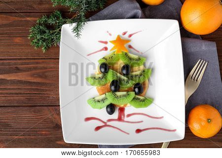Christmas food idea for kids breakfast, on wooden background
