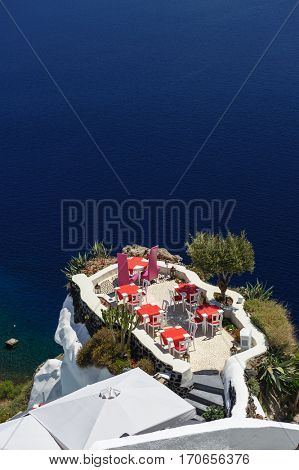 Luxury outdoor sea view cafe of Oia, Santorini, Greece. Lot of copyspace.