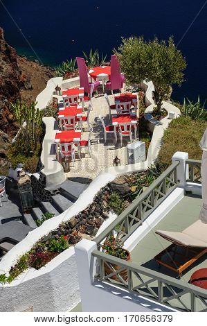 Luxury outdoor sea view cafe of Oia, Santorini, Greece.