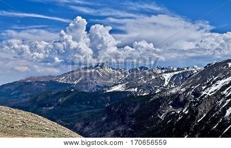 White clouds over mountain peaks. Rocky Mountains National Park. Estes Park.  Denver. Colorado. United States.