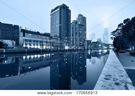 SHANGHAI CHINA - MARCH 19: Suzhou Creek on March 19 2016 in Shanghai China. Suzhou Creek (or Soochow Creek) also called Wusong River is a river that passes through the Shanghai city centre. Blue toned photo