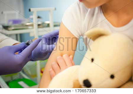 The pediatrician or nurse to vaccinate boy or girl, child vaccination