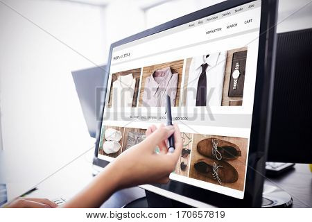 shop with style homepage against casual businesswoman touching her computer Casual businesswoman touching her computer with a pen