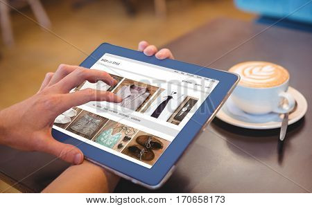 shop with style homepage against close-up of digital tablet and coffee on table Close-up of digital tablet and coffee on table in the coffee shop