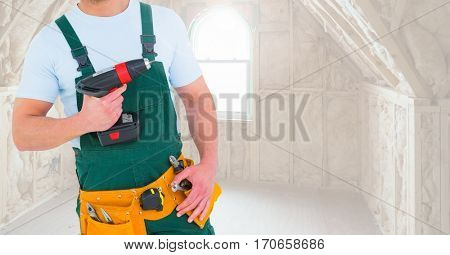 Mid section of handyman holding drilling machine at home