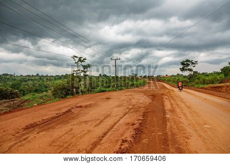 Wide angle view Uganda road on a cloudy day, African roads