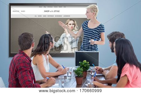 Casual businesswoman giving presentation to her colleagues against website frontpage