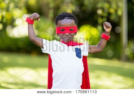 Young child is dressing up as a hero at park