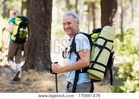 Man smiling and hiking on the wood