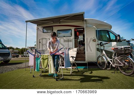 Washing on a dryer at a campsite. Caravan car Vacation. Family vacation travel, holiday trip in motorhome