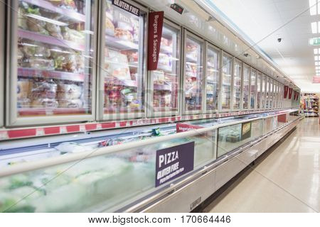 Facing view of frozen aisle in grocery store