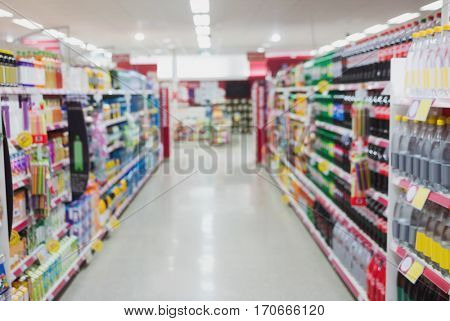 Focus on a aisle with shelves at supermarket
