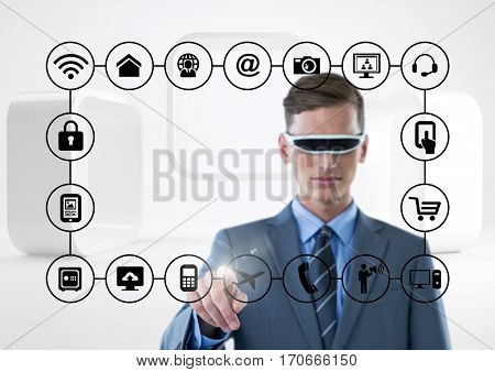 Businessman with using virtual reality headset touching connecting icons against digital generated background