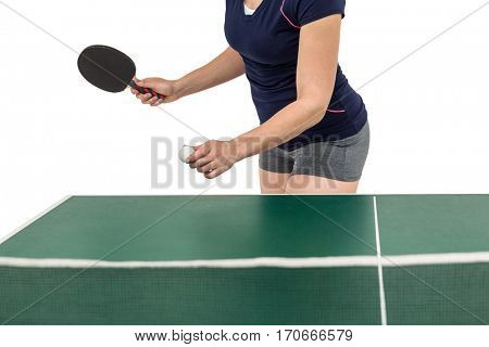 Female athlete playing table tennis on white background