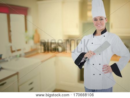 Portrait of female chef holding knife against digitally generated kitchen