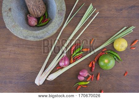Combine soup, herbal Thai Food on the wooden background . Tom Yum .