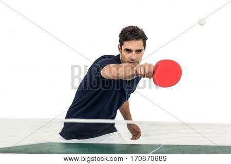 Portrait of male athlete playing table tennis on white background