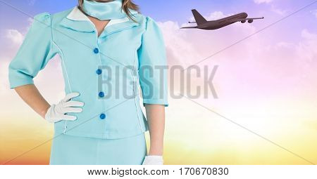 Mid section of air hostess with hands on hip against digitally generated background