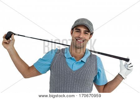 Portrait of golf player holding a golf club on white background